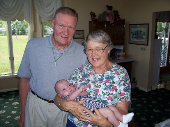 A photo of Carl Diener and Margaret Diener with an infant Samuel Diener.