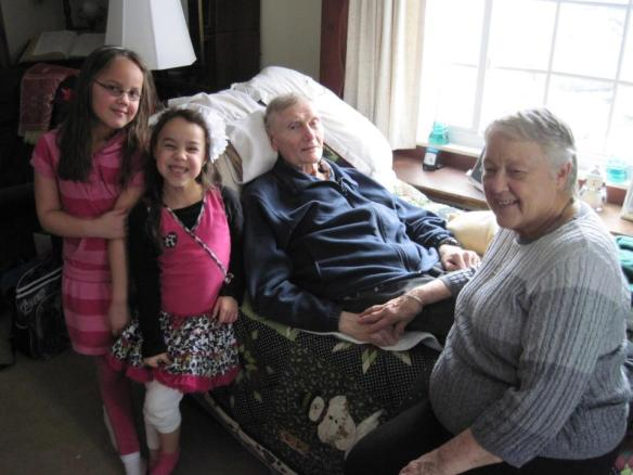 A photo of Rowan and Ava with Grandpa and Grandma Diener two weeks before Dad's death.